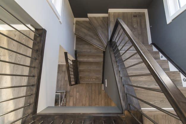 beautiful-shot-modern-house-staircase_181624-3129